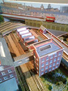 Have a look of this wonderful building, there is a small bridge over the rails which makes it easy to move from one building to another. Don't you think that this engineering model can save lots of precious time to travel from one building to another? :)