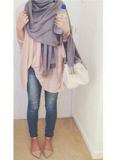Large grey scarf with fringe, and cream poncho, blue jeans and pointed toe flats.