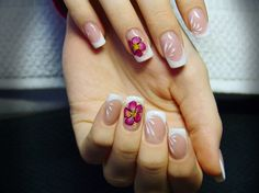 Make your nails come alive with this bright and floral French manicure ensemble! Coat your nails in clear white polish and follow the regular French tip pattern by coating on white polish and slowly tracing the line of your mail tips. To add drama into your nails, paint on magenta colored hibiscus flowers and catch everyone's attention with your awesome looking nails.