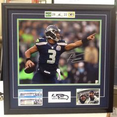 BF came in to our shop one afternoon with his family. They are die-hard Seahawks fans, and BF's son (in his early teens) saw the signed 16×20 print of Russell Wilson on the wall. He must of looked at it for several minutes. He was mesmerized. On their way out, BF said that he would come back because his son's birthday was coming up and he was thinking about getting him this piece of memorabilia. BF did return and wanted us to re-mat the print with some additional items. He had their tickets…