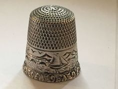 Antique Thimble by Thomas F. Brogan. Sailing theme. Stamped sterling with a star. Lighthouse mountain and sea motif. Thomas F. Brogan - New York, NY, active c. 1896-1930
