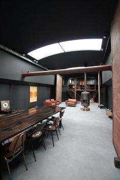 An atmospheric houseboat hits the market in Amsterdam - The Spaces Dark Interiors, Industrial Interiors, Dutch Barge, Houseboat Living, Floating House, Narrowboat, Tiny House Movement, Concrete Floors, Rustic Design