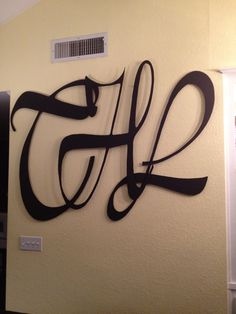 Custom Monogram, mounted with spacers, to allow shadowing.