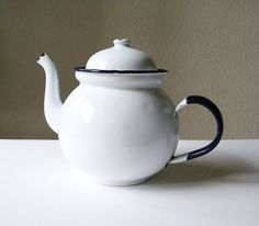 I love this vintage white enamel teapot. It is white with deep blue trim and handle.  It says at the bottom.. made in Poland.    Size:  length from spout to handle:25cm (9.8 inches)  hieght:16cm (6.3 inches)    The teapot is not in good condition. It is worn and has some rust on the inside of the lid and a little by the handle.Inside is yellowish marks and scratches.There are chips/scratches in the enamel and does have scratches.    Please note that I ship from France so shipping times are…