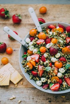 Strawberry Caprese Farro Salad. Hearty farro is tossed with homemade pesto, strawberries, tomatoes, and mozzarella cheese to create this beautiful summer grain salad!