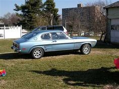 I had a 1973 Mercury Capri (the sexy European car) but mine was red. It had a engine and a sunroof. Had it from when I bought a brand new 1979 Ford Pinto. Ford Pinto, Mercury Capri, Ford Capri, First Car, Car Ford, Mk1, Rhodes, My Ride, Yahoo Images