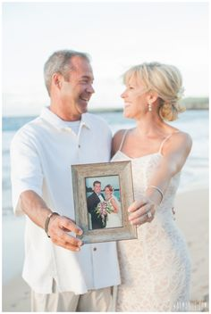 Beach Vow Renewal Photo Idea -- hold a photo from your original wedding :: Vow Renewals Maui Vow Renewal Dress, Vow Renewal Beach, Vow Renewal Ceremony, Beach Vow Renewals, Wedding Vow Renewals, Vow Renewal Wedding, Wedding Anniversary Pictures, Beach Wedding Photos, Anniversary Ideas
