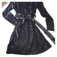 Black sequin dress Black sequin mini dress. Comes with satin belt. Can be worn with or without! Notice in last picture side loop is broken. Belt still works without loops anyway! Price reflects damaged loops. Express Dresses Long Sleeve
