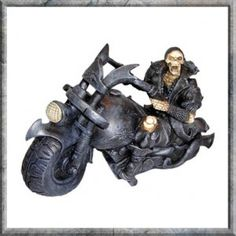 Screaming Wheels Skeleton Biker Ornament Figurine. A resin skeletal biker on a classic styled Lowrider bike.