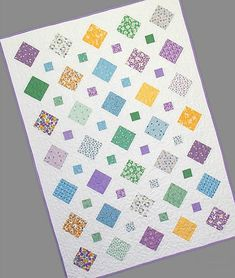 modern quilting designs Any Color Theme is Wonderful! What do you make if you have one charm pack? Show off the 5 squares in this pretty quilt. One charm pack, plus a background Charm Pack Quilt Patterns, Charm Pack Quilts, Beginner Quilt Patterns, Charm Quilt, Baby Quilt Patterns, Modern Quilt Patterns, Quilting Patterns, Quilting Ideas, Modern Baby Quilts