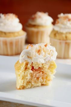 Coconut Cupcake  2/3 cup sugar  1/2 cup (1 stick) butter, room temperature  2 eggs  1 teaspoon vanilla extract  1 1/2 cup all purpose flour  1/2 cup sweetened flaked coconut  2 teaspoons baking powder  2/3 cup coconut milk