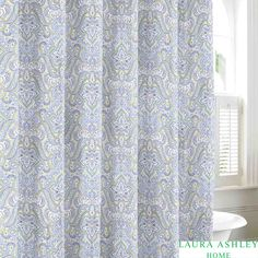 Add beauty to your bathroom with the Laura Ashley Maiden shower curtain. Made from 100-percent cotton, this charming curtain features a scroll pattern, and blue and green finish to complete the look.