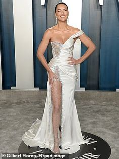 Drop-dead gorgeous: Adriana brought the glamour in a pale white gold gown which came compl...