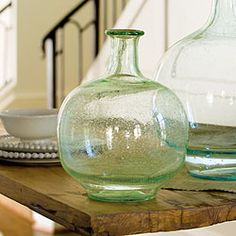"""We're addicted to these statement vases, modeled after demijohn bottles used in wine making. Fantastic with large leaves, flowers or branches, they can't be beat as stand-alone pieces. Our stylists love adding them to every room for extra shine and a hint of color — bring them into your home and explore the possibilities. (8 1/2"""" diameter x 11 1/2"""" tall) $40.96"""