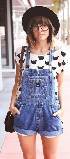 white cat patterned shirt and overalls with black purse