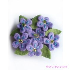 Delicate felt flower forget me not brooch that can also be made as a flower pendant. Lilac flowers are hand embroidered with pale blue and lemon