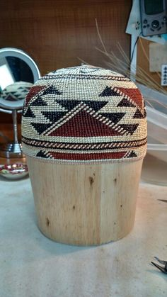 Karuk basket hat woven by Denna Dodds, second finished :) Made with willow sticks. Wild grape root and spruce root. Overlay is beargrass, black fern, and woodwardia fern dyed with alder bark.