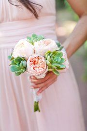 Pretty succulent bouquet. Thinking this but with white peonies for bridesmaids.