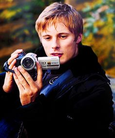 Bradley and his camera. I find this extremely adorable.