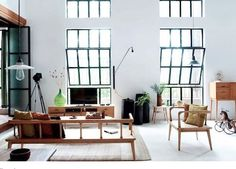 Love the black steel windows and the pendant light fitting