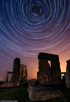 Talented: Photographer David Sharp spent countless hours observing the night skies and patiently waiting for the perfect shots.. Stonehenge... England .. Daily Mail