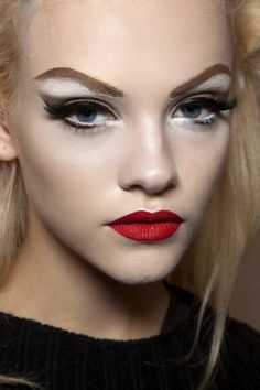 beauty-student:  Inspired by drag queen makeup…why not?! They are the masters of blending. Great trick if you want to temporarily raise your brows. Gorgeous sharp lip highlighted at the cupids bow and I love the thick lashes and liner. Drag 1950s.