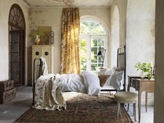 LOVE this. high positioned window covering, arched doorway, creamy walls, ceiling mural