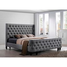 Update your bedroom with this elegant Malibu Platform bed, perfect for your king size mattress. A button-tufted, winged headboard and footboard complete the beauty of the platform frame, all in simple grey upholstery.