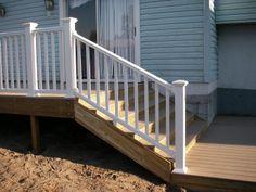 grey house with deck | Vinyl Deck Rail