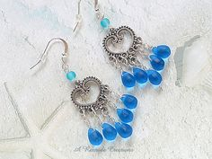 Hey, I found this really awesome Etsy listing at https://www.etsy.com/il-en/listing/281117474/sapphire-sea-glass-earrings-beach-glass