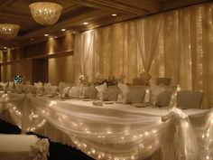 Tiered wedding head table w/ lighted backdrop - Royale Ballroom at the Crowne Plaza Lansing West