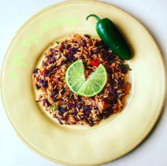 Spicy Spanish Rice and Beans: 2 servings:  Boil 1/2 cup long grain brown rice in a little over 1 cup of veggie broth.  In a pan, fry onions, chopped tomato, mushrooms, and one jalapeño pepper (if you want it REALLY spicy, leave the seeds and all ) in olive oil, garlic, oregano, paprika, chile powder, and lime. Next, add in a can of black beans (rinse them first!). Add the beans mixture to the rice.
