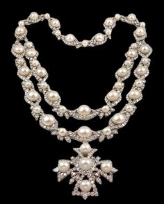 Van Cleef & Arpels   Sautoir ......A magnificent double row necklace suspending a Maltese cross set with over 100 carats of diamond and superb South Sea pearls mounted in platinum, detachable to form various items. Commissioned 1967 Van Cleef & Arpels New York