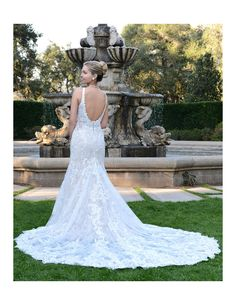Breathtaking fitted lace gown available at Spotlight Formal Wear! #SpotlightBridal