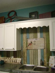 Beach Cottage - Old salvaged beadboard. I love how it looks with the fresh white cabinets and metal counters. Aren't all of the colors wonderful…
