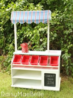 This would be SO COOL for a cookie booth!! Love the display shelves up front!!   Child's Lemonade Stand | daisymaebelle