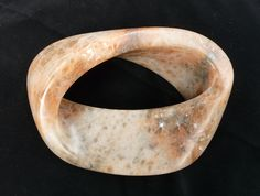 """Nicholas Durnan, 2010, Mobius 3 (English Alabaster). """"Carved completely in the round.... Very unusual colouring for alabaster which was only fully revealed after polishing."""" Quoted fromlink"""