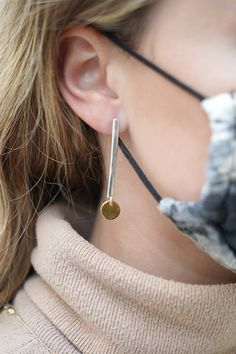"Gear up for a trip to the desert with these simple earrings. Perfect for packing in your carry-on, the two-tone drops feature a sterling silver bar capped with a round, gold-flashed disc that oozes delicate shine. Earrings measure 2 by 3/8 inches and feature posts with friction-backs. Pieces come with "".925"" sterling silver stamps as symbols of guaranteed product quality. Simple Earrings, Silver Earrings, Drop Earrings, Fall Jewelry, Silver Bars, Unique Colors, Signature Style, Two By Two, Delicate"