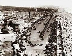 This view down the Great Highway shows Playland, a popular San Francisco amusement park. The windmills in the background were used to pump water to Golden Gate Park.