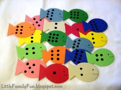 """put dots on cut out fish, add paper clip and have kids """"fish""""...  pick two and then have the kids add the numbers together"""