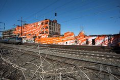 katharina grosse colorizes railway landscape for train riders