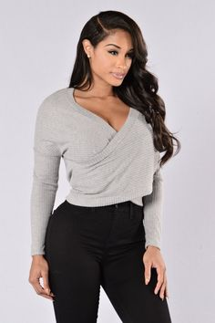 - Available in Heather Grey and Denim - Sweater - Ribbed - Overlap Front - V Neckline - Long Sleeve - Made in USA - 90% Polyester 10% Spandex