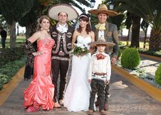 A family dressed in traditional charro clothing celebrating a wedding in Jalisco, Mexico
