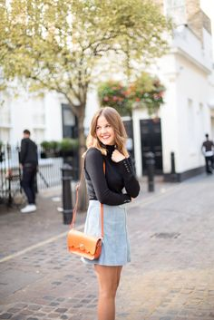Kim from @LoveClothBlog wears our Small Cloud Bag in Ember Orange.