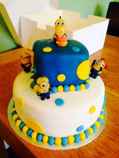 2 Tier Despicable me minion cake. Sponge is marble with both chocolate and vanilla buttercream.