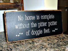 Primitive Wooden Sign No Home Is Complete Without The Pitter Patter of Doggie Feet via Etsy