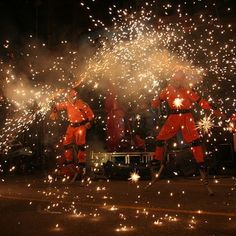 Bouncers | ACROBACK Pyro boots flames shoot off the heads, arms and rocket propel the bouncers into space as pyrotechnics attached to bounce bodes create a dynamic human firework display
