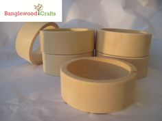 Unfinished Wooden Bangles with a flat exterior    http://www.etsy.com/shop/BanglewoodSupplies