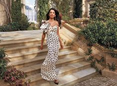 Amal Clooney photographed at home. Johanna Ortiz dress. Van Cleef & Arpels earrings. Christian Louboutin shoes.