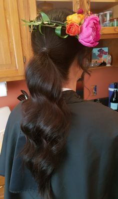 A low ponytail with deep waves and a flower crown, perfect for the bridesmaids in an outdoor wedding. By Shana Montgomery owner of Fringe Theory.